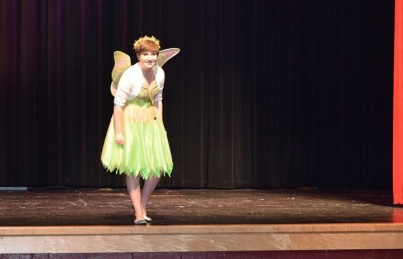 "Elise as ""Tink"" leads a Princess Boot Camp production."